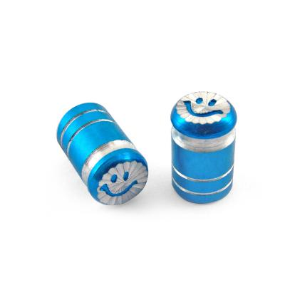 Bouchon de valve smile bleu anodise 1004b (la paire)